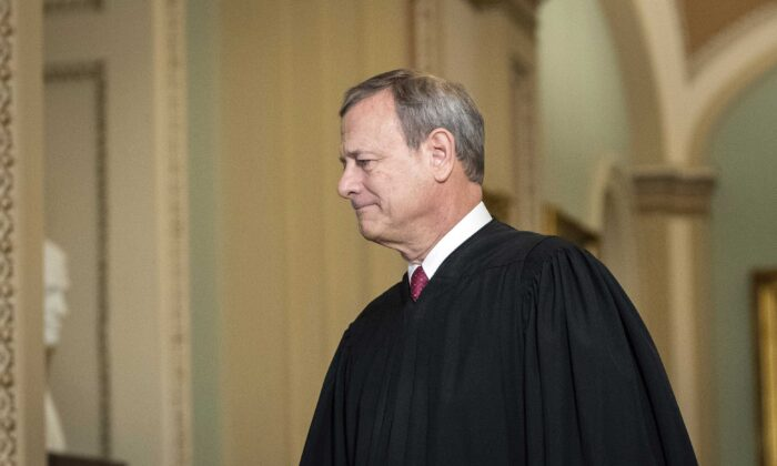 Supreme Court Chief Justice John Roberts arrives to the Senate chamber at the Capitol in Washington on Jan. 16, 2020. (Drew Angerer/Getty Images)