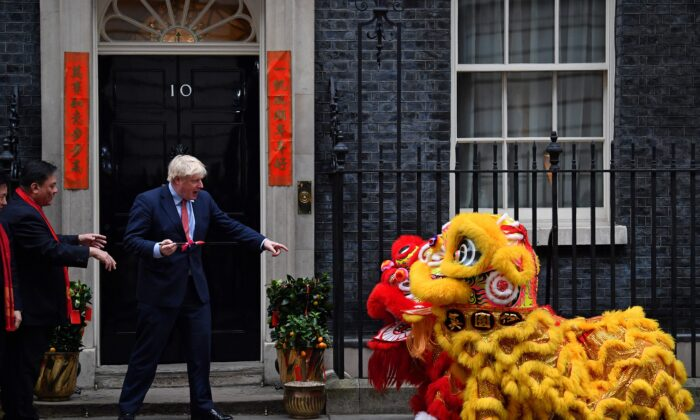 Britain's Prime Minister Boris Johnson prepares to paint the eyes on Chinese Lions, as he hosts a Chinese New Year reception at 10 Downing Street in central London on January 24, 2020. (Ben Stansall/AFP via Getty Images)