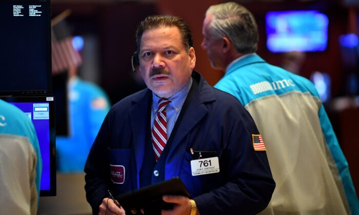 Traders work during the opening bell at the New York Stock Exchange (NYSE) at Wall Street in New York City, U.S. on March 19, 2020. (Johannes Eisele/AFP via Getty Images)