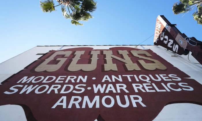 A sign is posted at the Martin B. Retting, Inc. guns store as the coronavirus pandemic continues on March 24, 2020 in Culver City, California. (Mario Tama/Getty Images)