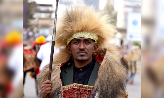 Ethiopian musician Haacaaluu Hundeessaa poses while dressed in a traditional costume in Addis Ababa, Ethiopia, on March 2, 2019. His costume celebrates the 123rd anniversary of the battle of Adwa, where Ethiopian forces defeated invading Italian forces. (Tiksa Negeri/Reuters)