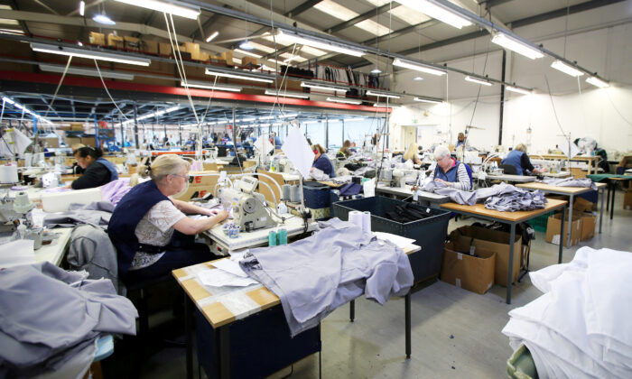 Tibard employees make uniforms for health workers at NHS at their factory in Dukinfield, Britain, on April 6, 2020. (Molly Darlington/Reuters)