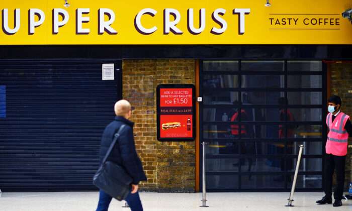 A pedestrian walks past a closed-down and shuttered Upper Crust food outlet in Charing Cross train station in London, UK, on July 1, 2020. (Ben Stansall/AFP via Getty Images)