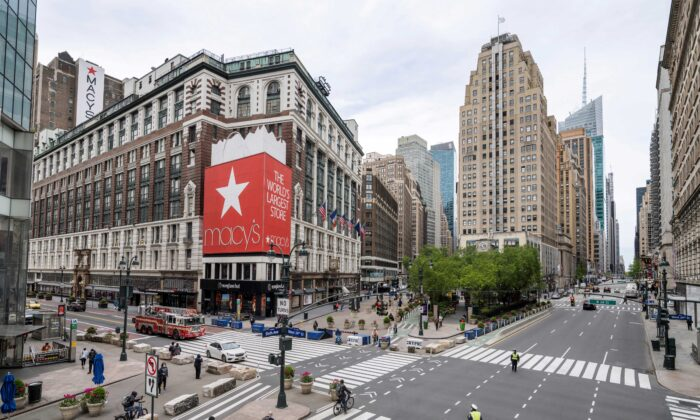 A firetruck drives down 34th street past a closed Macy's and Herald Square as streets remain less busy due to the continuing outbreak of the COVID-19 in New York City, on May 5, 2020. (Lucas Jackson/Reuters)