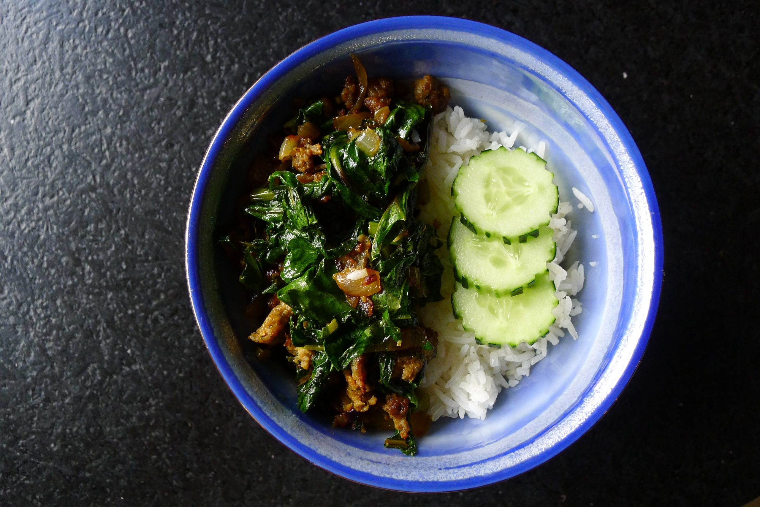 beet greens and sausage over rice
