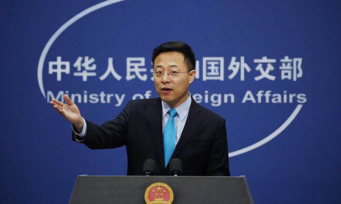 Chinese Foreign Ministry new spokesman Zhao Lijian gestures as he speaks during a daily briefing at the Ministry of Foreign Affairs office in Beijing on Feb. 24, 2020. (Andy Wong/AP Photo)