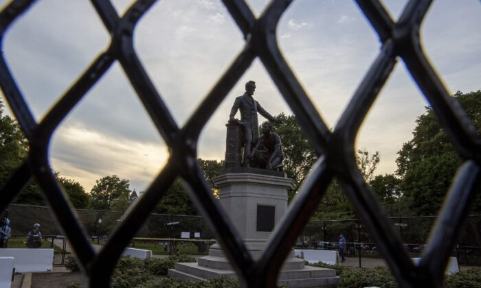 Fencing erected to protect the Emancipation Memorial from people who said they want to tear it down is pictured in Washington on June 26, 2020. (Tasos Katopodis/Getty Images)