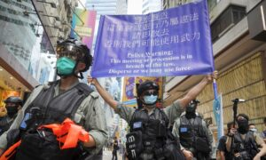 Hong Kong Police Make First 2 Arrests Under National Security Law