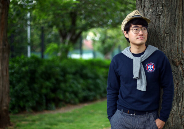 Simon Cheng, a former British Consulate employee, poses for a photograph in London