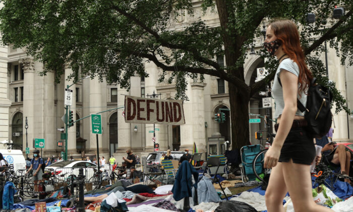Activists and protesters occupy an area across from City Hall in Manhattan before a city council decision on police funding in New York on June 30, 2020. (Charlotte Cuthbertson/The Epoch Times)