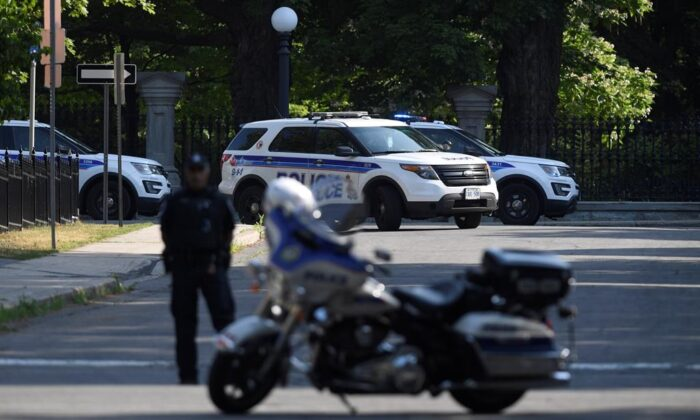 A police barricade is set up near Rideau Hall in Ottawa on July 2, 2020. (The Canadian Press/Adrian Wyld)