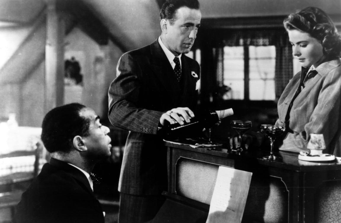 "black man, white man, woman, at piano in ""Casablanca"""