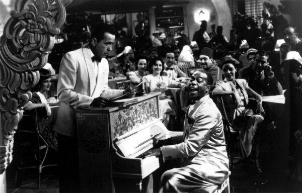 "two men at piano in white jackets in ""Casablanca"""