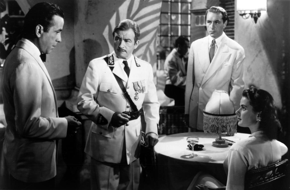 """three men and seated woman in """"Casablanca"""""""