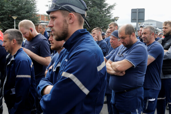 Employees attend a general meeting outside the factory of Stelia Aerospace, a subsidiary of Airbus, in Meaulte