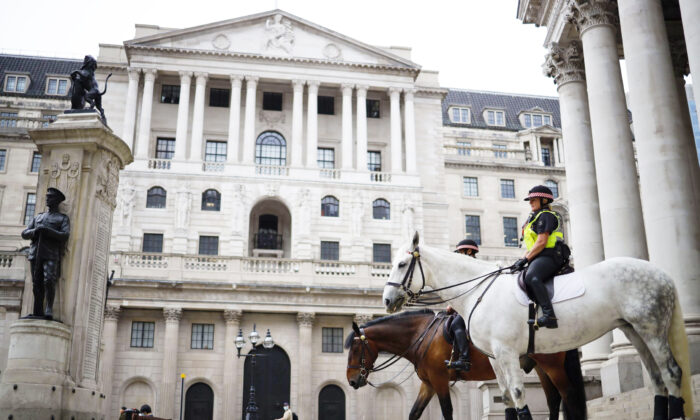 Mounted police officers sit outside the Royal Exchange and the Bank of England in London, UK, on June 17, 2020. (Tolga Akmen/AFP via Getty Images)