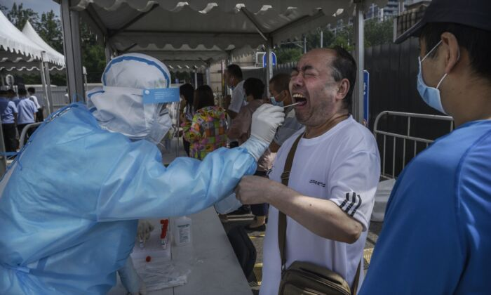 A Beijing resident receives the nucleic acid swab test for COVID-19 at a testing site in Beijing, China on July 1, 2020. (Kevin Frayer/Getty Images)