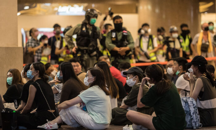 Riot police detain people after they cleared protesters taking part in a rally against a new national security law in Hong Kong on July 1, 2020. (Dale De La Rey/AFP via Getty Images)