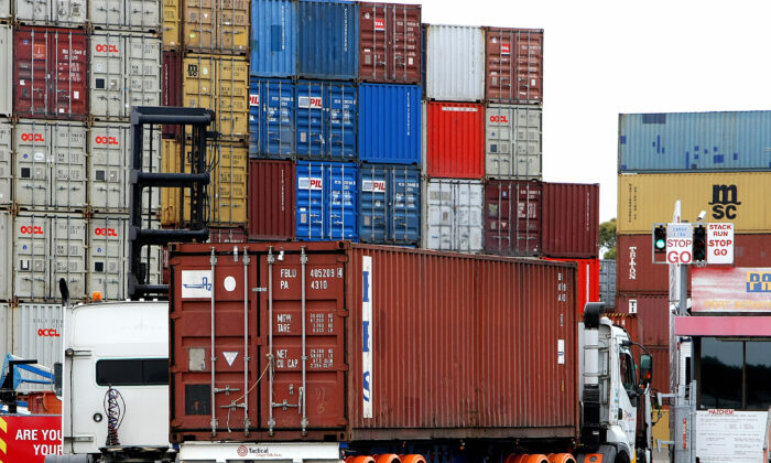 Container trucks arrive at Port Botany's maritime dock near Sydney on November 26, 2008. (GREG WOOD/Getty Images)