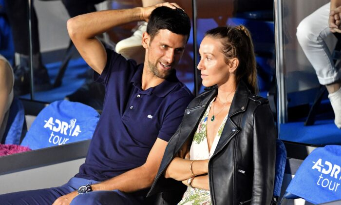 Serbian tennis player Novak Djokovic (L) talks to his wife Jelena during a match at the Adria Tour, Novak Djokovic's Balkans charity tennis tournament in Belgrade on June 14, 2020. (Andrej Isakovic /AFP via Getty Images)