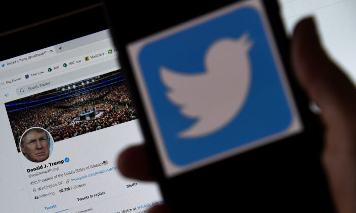 In this photo illustration, a Twitter logo is displayed on a mobile phone with President Trump's Twitter page shown in the background  in Arlington, Va., on May 27, 2020. (Olivier Douliery/AFP/Getty Images)