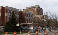Short-Staffed Michigan Hospitals Cut Workers, Beds Amid Patient Surge