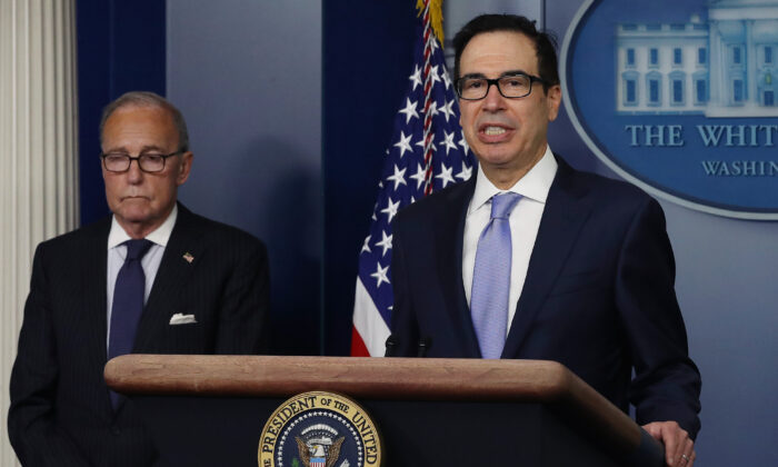 Treasury Secretary Steven Mnuchin speaks to the media while flanked by White House National Economic Council director Larry Kudlow in the briefing room at the White House on July 2, 2020. (Somodevilla/Getty Images)