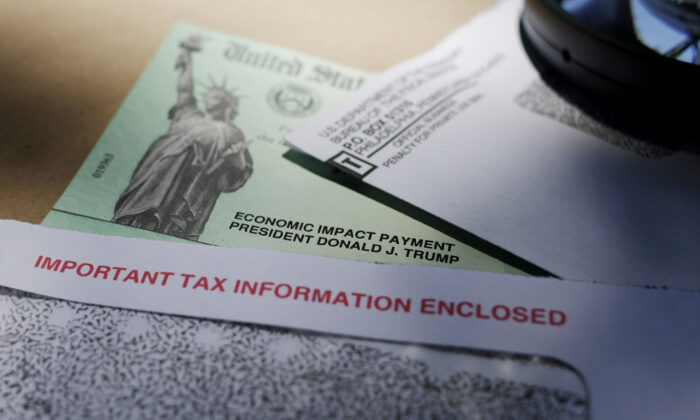 In this April 23, 2020, file photo, President Donald Trump's name is seen on a stimulus check issued by the IRS to help combat the adverse economic effects of lockdowns imposed to try to curb the spread of the coronavirus, in San Antonio. (Eric Gay/AP Photo)