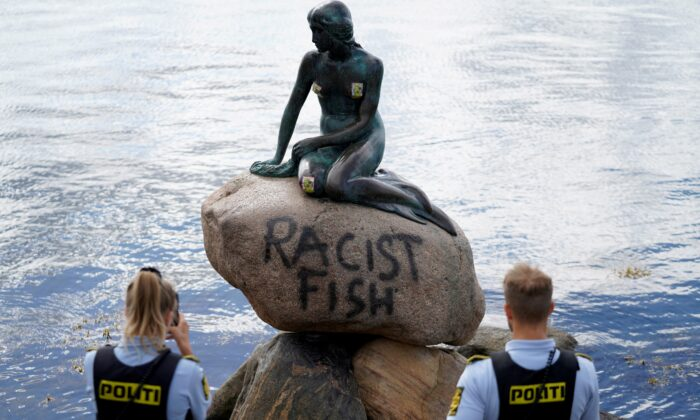 "Graffiti reading ""Racist Fish"" is seen on a statue of the Little Mermaid in Copenhagen, Denmark, on July 3, 2020. (Ritzau Scanpix/Mads Claus Rasmussen via Reuters)"