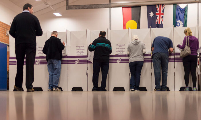 Federal Labor's candidate for Eden Monaro Mike Kelly (far left) votes in the electorate of Eden-Monaro on July 2, 2016 in Canberra, Australia.  (Martin Ollman/Getty Images)