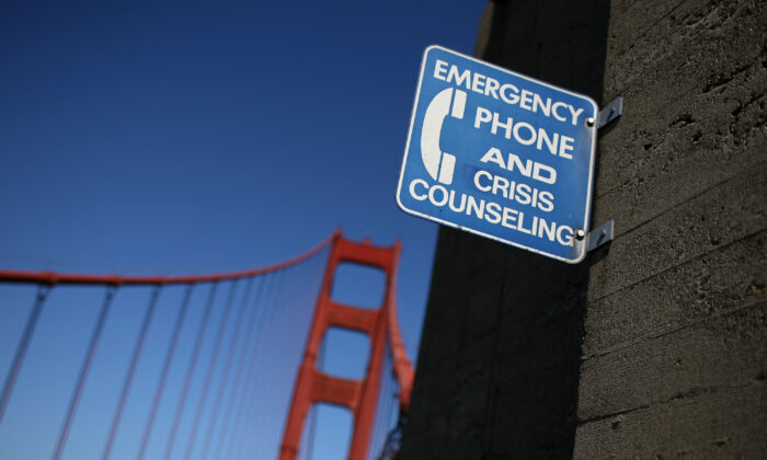 A sign for an emergency phone is seen on the span of the Golden Gate Bridge in San Francisco, Calif., on Oct. 10, 2008. (Justin Sullivan/Getty Images)