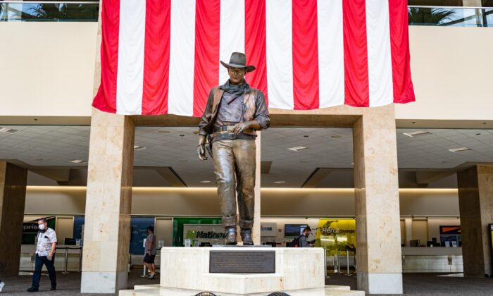 A 9-foot-tall statue of John Wayne stands at John Wayne Airport in Orange County, Calif., on June 26, 2020. (John Fredricks/The Epoch Times)
