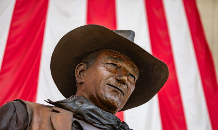 A statue of actor John Wayne is seen at John Wayne Airport, which serves Orange County, Calif., on June 26, 2020. The Democratic Party of Orange County has called for the statue to be removed and the airport renamed. (John Fredricks/The Epoch Times)