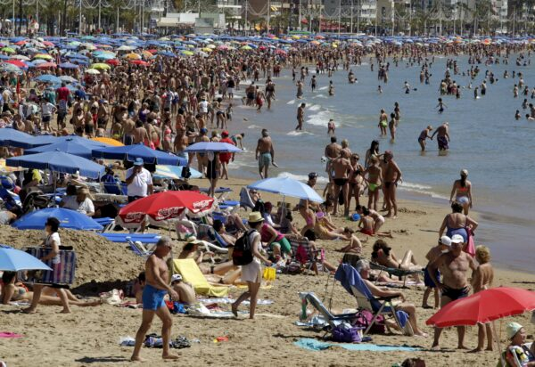 People visit the beach in the Spanish south-eastern town of Benidorm