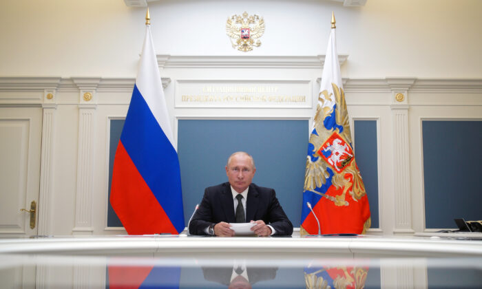 Russian President Vladimir Putin takes part in a video conference call, dedicated to the opening of new military medical centres for patients infected with the coronavirus disease (COVID-19), in Moscow, Russia, on June 30, 2020. (Alexei Babushkin/Reuters)