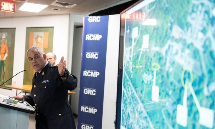 RCMP Deputy Commissioner Mike Duheme points toward a map with timestamps indicating the path of Corey Barclay Hurren, who breached the gates of Rideau Hall on the morning of July 2, during a news conference at the RCMP National Division in Ottawa on July 3, 2020.  (The Canadian Press/Justin Tang)