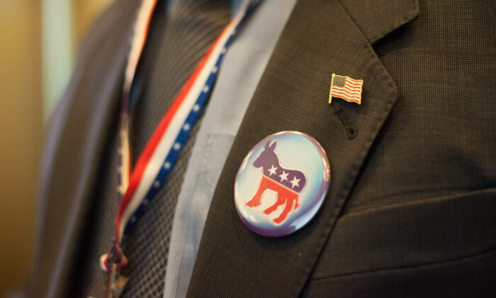 File photo of a man wearing a Democrat badge (Will Oliver/AFP/Getty Images)