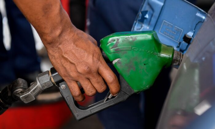 A person pumps petrol into a vehicle at a gas station in Caracas, Venezuela, on June 1, 2020. (Federico Parra/AFP via Getty Images)