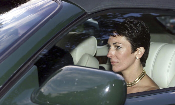 British socialite Ghislaine Maxwell, driven by Britain's Prince Andrew, leaves the wedding of a former girlfriend of the prince, Aurelia Cecil, at the Parish Church of St Michael in Compton Chamberlayne near Salisbury, England, on Sept. 2, 2000. (Chris Ison/PA via AP)
