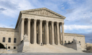 Barrett Absent as Supreme Court Refuses to Block Extended Ballot Deadlines