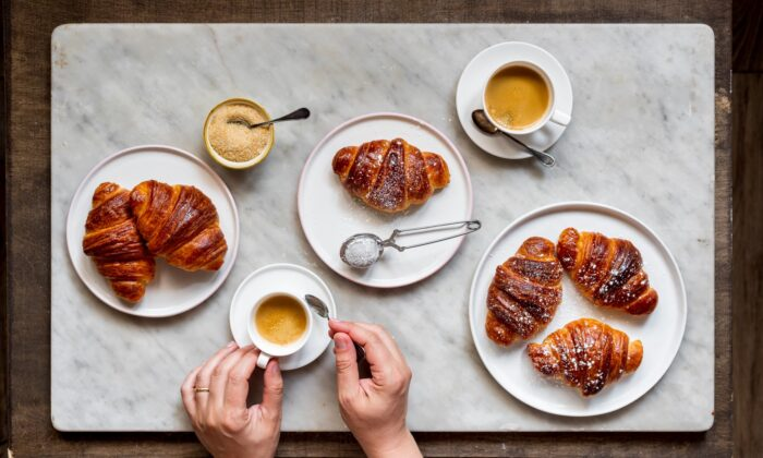 Soft, flaky, and rich, with glossy surfaces brushed with vanilla syrup, cornetti are Italians' breakfast pastry of choice, typically enjoyed with a cappuccino. (Photo by Giulia Scarpaleggia)