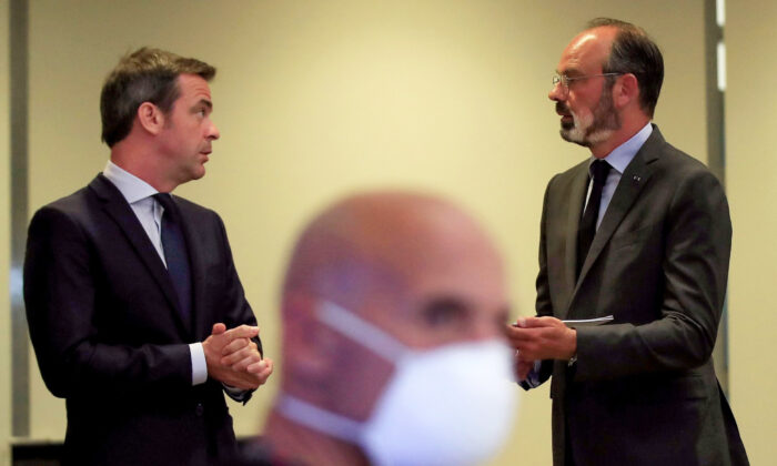 French Prime Minister Edouard Philippe (R) chats with French Minister for Solidarity and Health Olivier Veran at the Health Ministry in Paris, France, on May 25, 2020. (Michel Euler/POOL/AFP via Getty Images)