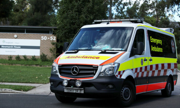 An New South Wales ambulance leaves Newmarch House with a patient on May 01, 2020 in Sydney, Australia. (Cameron Spencer/Getty Images)