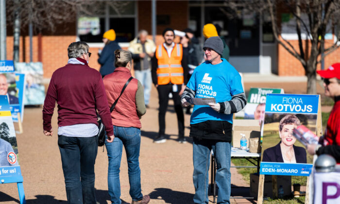 The rural seat of Eden-Monaro is holding a by-election. Voters and party representatives interact outside Bungendore Public School on July 04, 2020 in Bungendore, Australia. (Rohan Thomson/Getty Images)