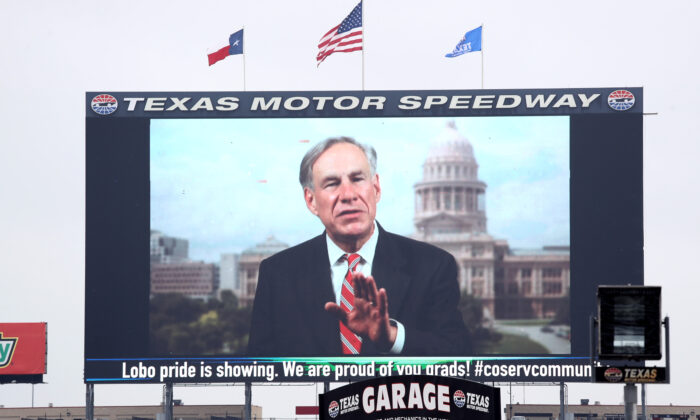 """Texas Gov. Greg Abbott is seen on """"Big Hoss TV"""" before Little Elm High School graduation ceremonies at Texas Motor Speedway in Fort Worth, Texas, on May 21, 2020. (Ronald Martinez/Getty Images)"""