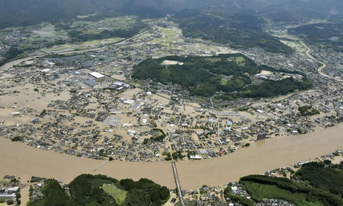 Areas are inundated in muddy waters that gushed out from the Kuma River in Hitoyoshi, Kumamoto prefecture, southwestern Japan on July 4, 2020. (Kyodo News via AP)