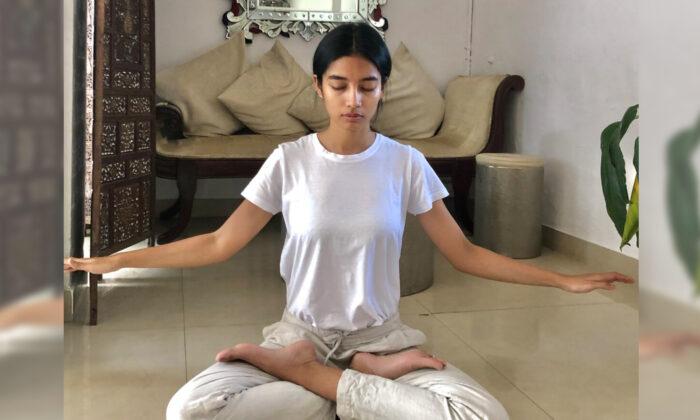 Sumaya Hazarika practicing the fifth set of Falun Gong exercises indoors. (Courtesy of Mark Luburic)