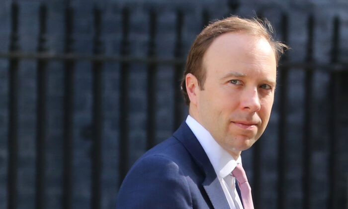 Britain's Health Secretary Matt Hancock leaves Downing street after the daily Covid-19 briefing in central London, on May 27, 2020. (Isabel Infantes/AFP via Getty Images)