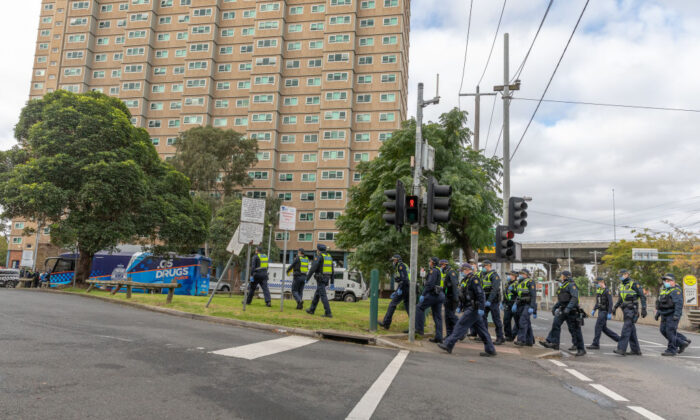 Protective service police officers walk towards the Flemington Public housing flats on patrol in Melbourne, Australia on July 05, 2020. (Asanka Ratnayake/Getty Images)