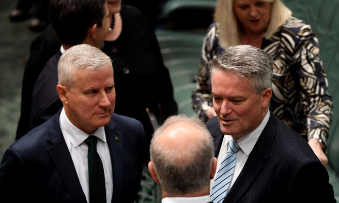 Australian Prime Minister Scott Morrison speaks to the Deputy Prime Minister Michael McCormack (L) and Senator Mathias Cormann (R) as they wait for the arrival of Indonesian President Joko Widodo to address the House of Representatives at Parliament House on Feb. 10, 2020 in Canberra, Australia. (Tracey Nearmy/Getty Images)